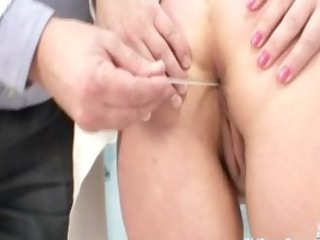 older woman examined at the doctors