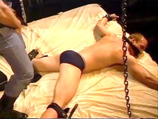 fellow in chains acquires tortured and stomped on