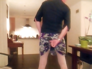 Skirt, panties, stockings and a dildo