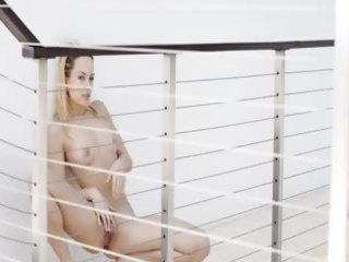 leila models blue fantasies on balcony