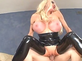 hot blond playgirl in dark latex acquires giant