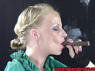 nico green gown and gloves cigar