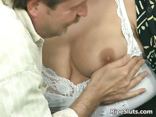 blond housewife sucks large penis with her