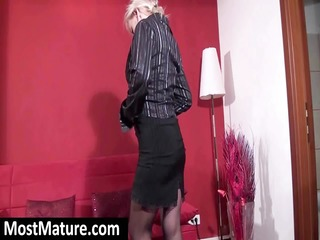 aged blond is putting on a show and taking off