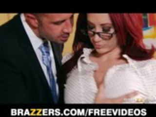 breathtaking redhead businesswoman closes a large