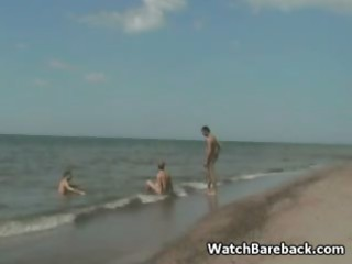 homosexual trio beach oral job