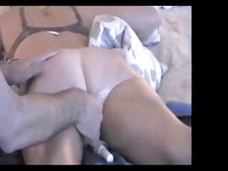 aged wife enjoys a little sex tool insertion