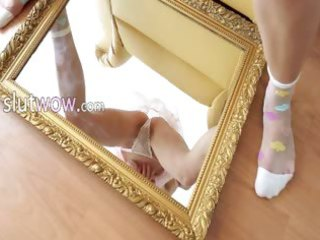 delicious gal playing with mirror
