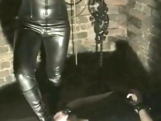 dominant-bitch wearing latex bodysuit burns balls