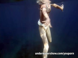 nastya swimming exposed in the sea