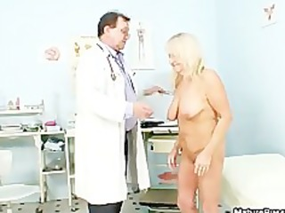smutty old doctor inspecting