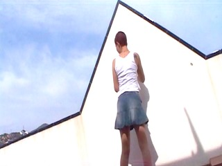 katia disrobes on the roof