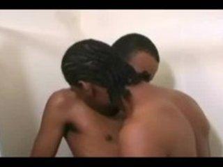 boyz giving a kiss in shower