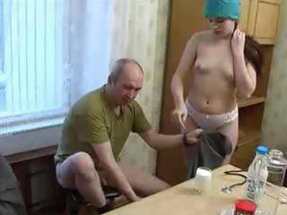 oversexed youthful nurse goes down on her old