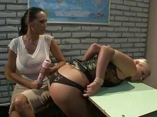 sluty golden-haired lesbo in leather corset likes