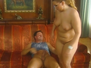 big beautiful woman blond in suit