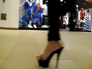 high heels -teen walking in the mall - darksome
