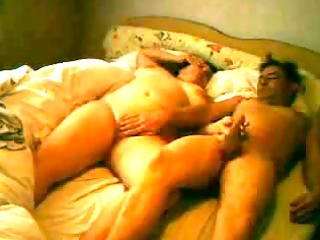 older pair playing in hotel room