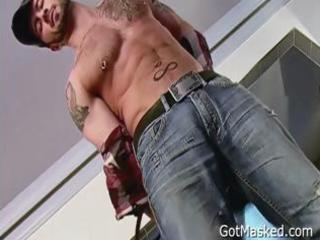 tattooed and pierced guy stripping