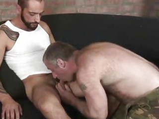 excited tattooed man fucking a curly bear