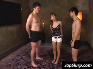 oriental girl takes hold of knobs in her face