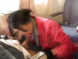 pretty stewardess engulfing a hard weenie