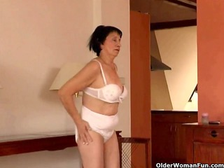 over 59 granny does striptease and masturbates