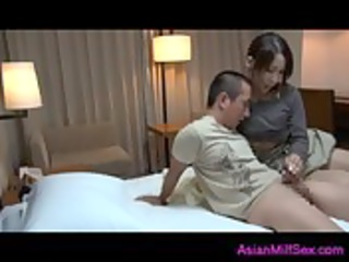 breasty mother i massaging lad jerking of his