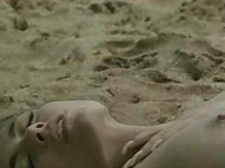 brunette hair getting laid on beach