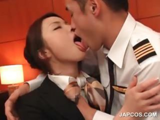 stockinged oriental flight attender receives