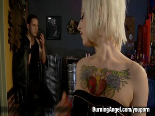 tattooed blond acquires drilled in a bar
