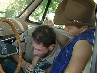 phat cop giving head to a cowboy in a car